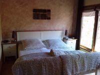 """Das größere Schlafzimmer mit Doppelbett - Bild 14: Ferienhaus """"Otto"""" in Garding auf Eiderstedt (4 Sterne)"""