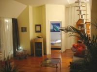 """Wohnraum mit Blick in das Schlafzimmer. Mit Pelletkamin - Bild 8: exklusiv Wohnen in Berlin-Mitte/Tiergarten im """"Blueberry Hill"""""""