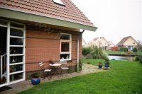 Bild 2: Haus Birgit mit eingezäunten Garten am Ijsselmeer für Urlaub mit dem Hund