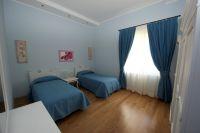Der Schlafraum mit Einzelbetten. - Bild 11: Giardino dei Colori - Schöne moderne 6 Pers. - Ferienwohnung am Gardasee