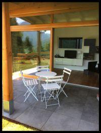 Bild 11: Ferienhaus Regina mit eingezäunten Garten und Seeblick