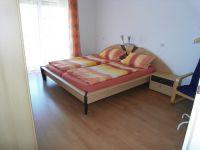 Schlafzimmer 1 - Bild 5: Ferienwohnung C im Ferienhaus Homburger