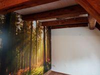 kleiner Blick ins Schlafzimmer mit der Baumrindenlampe - Bild 11: Außergewöhnliche luxuriöse Ferienwohnung im Schwarzwald